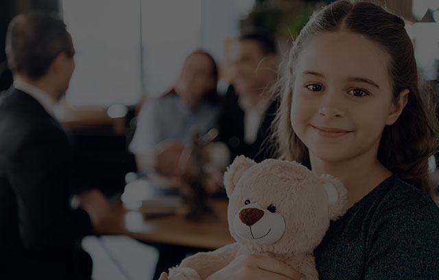 Little girl with teddy bear smiling